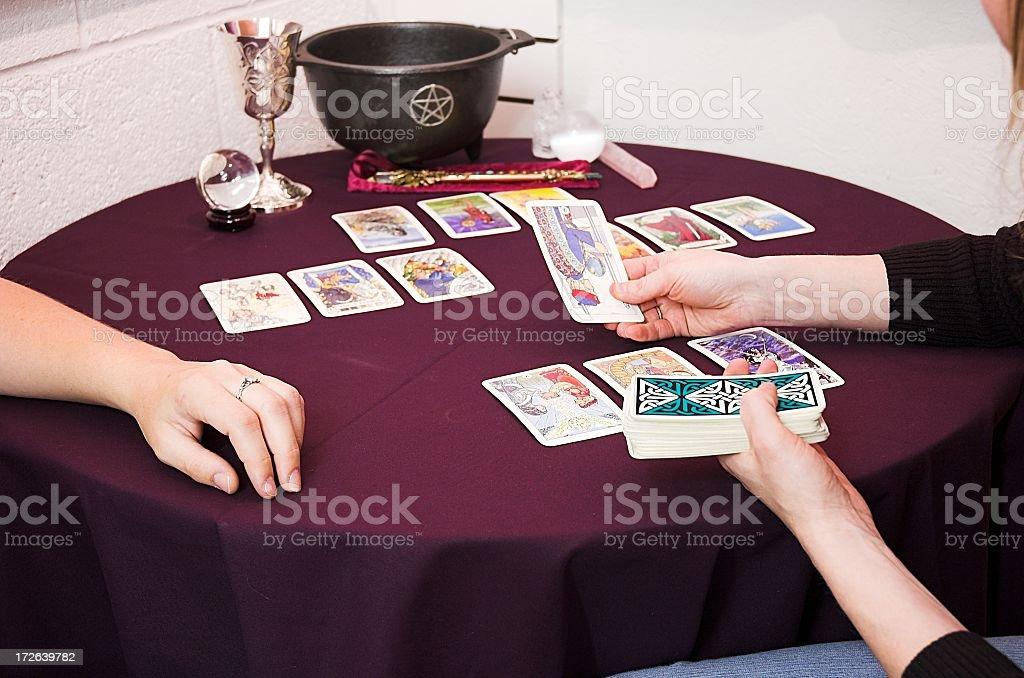 Woman telling another woman's future with tarot cards stock photo