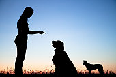 Woman Telling Dog To Stay