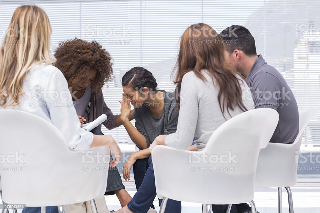 Woman telling her problems and crying royalty-free stock photo