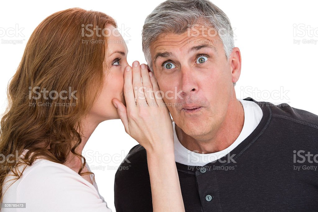 Woman telling secret to her partner stock photo
