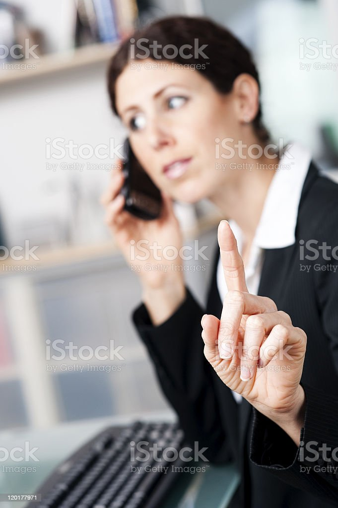 Woman telling you to stop talking so she can hear  stock photo