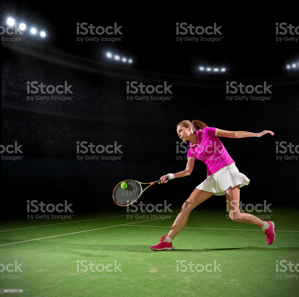 Woman tennis player on court stock photo
