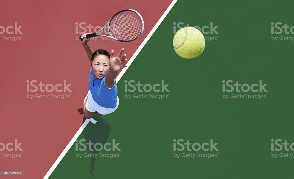 woman tennis player serving stock photo