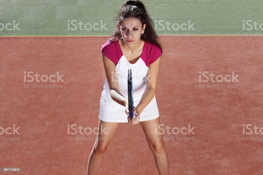 woman tennis player with racket during a match game, isolated stock photo
