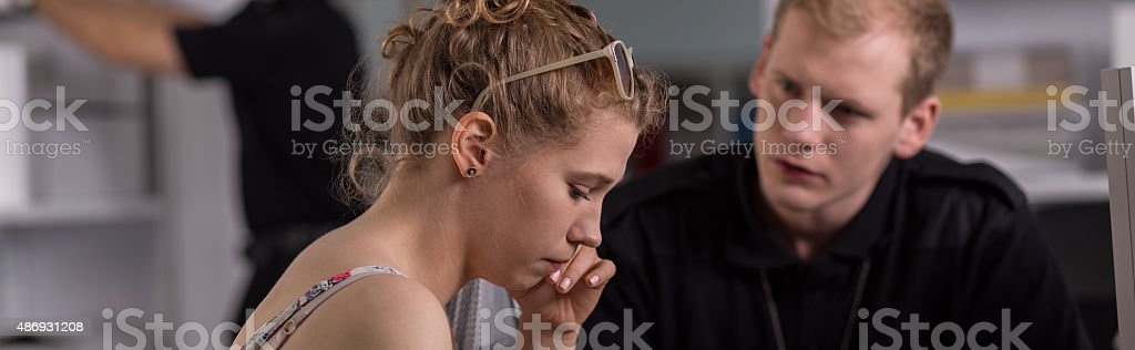 Woman testifying to the police stock photo