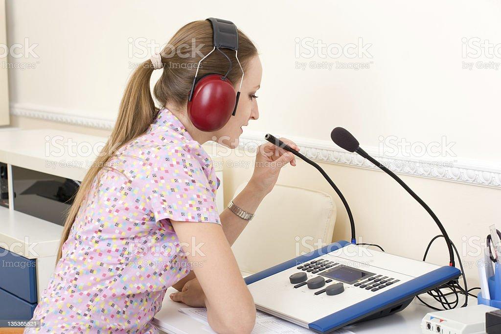 Woman testing hearing royalty-free stock photo