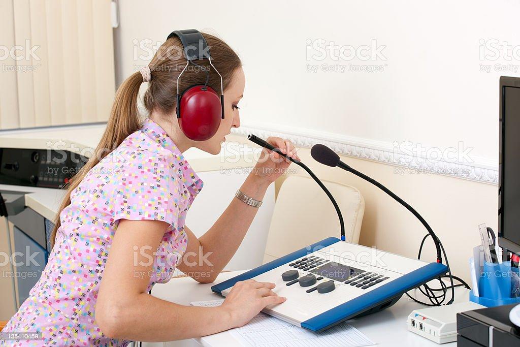 Woman testing hearing stock photo