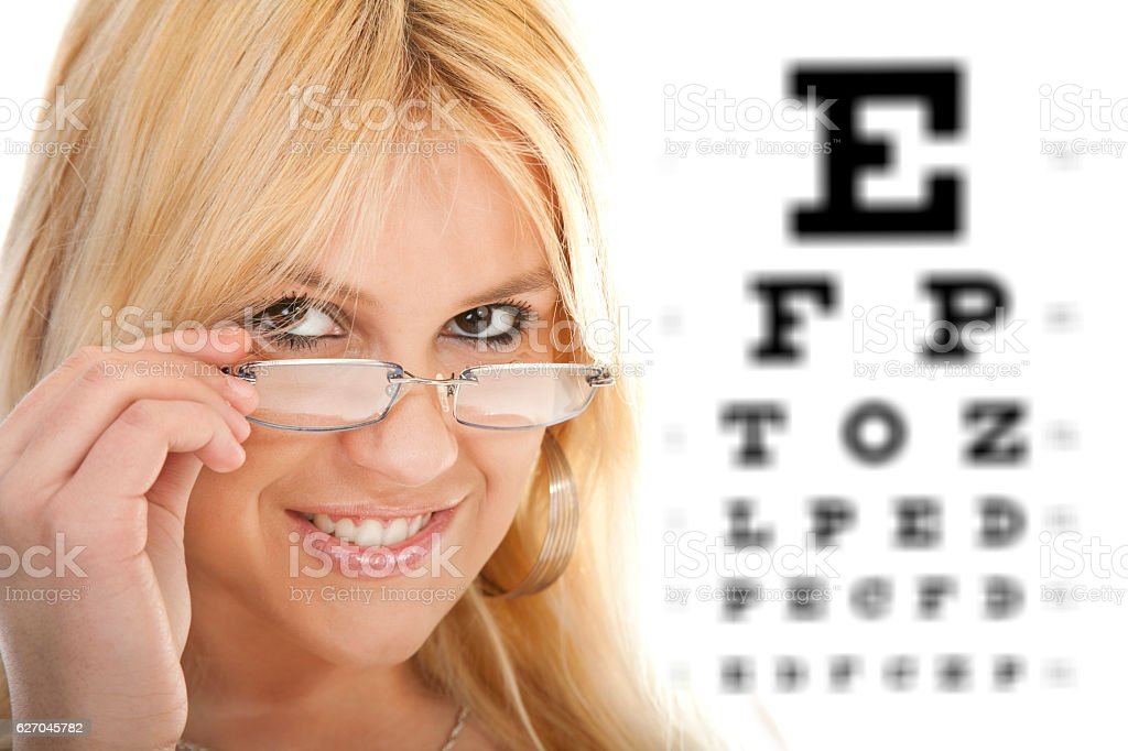 Woman testing her eyesight stock photo