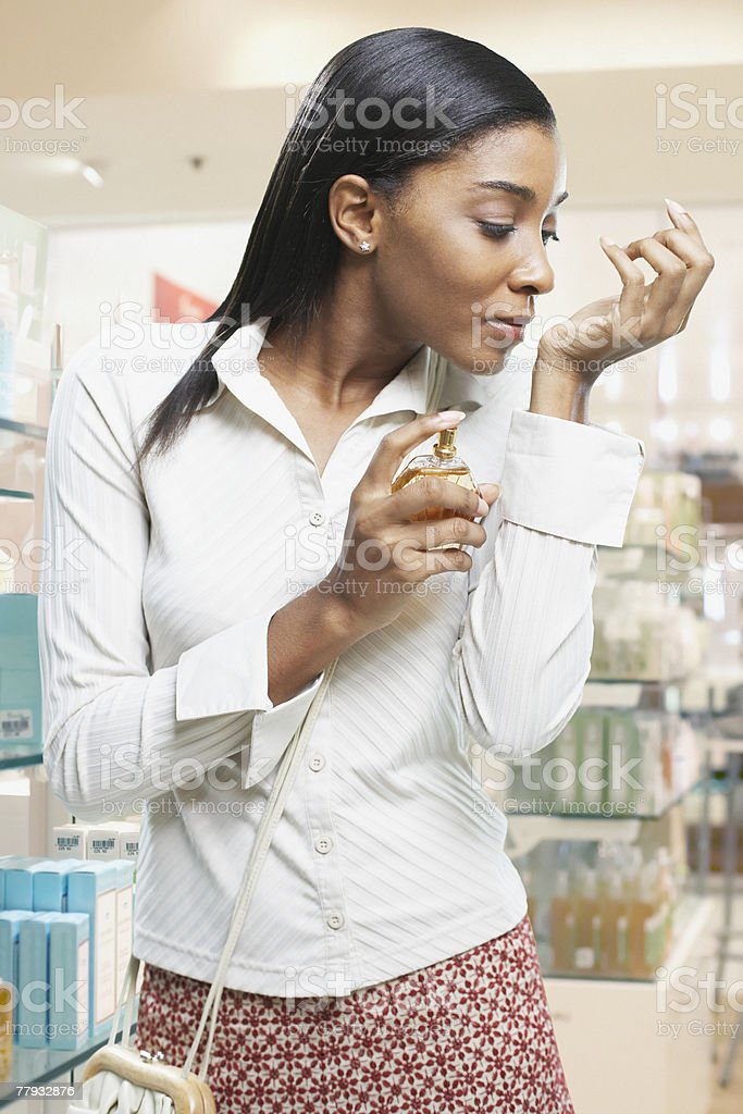 Woman testing perfume in a store royalty-free stock photo