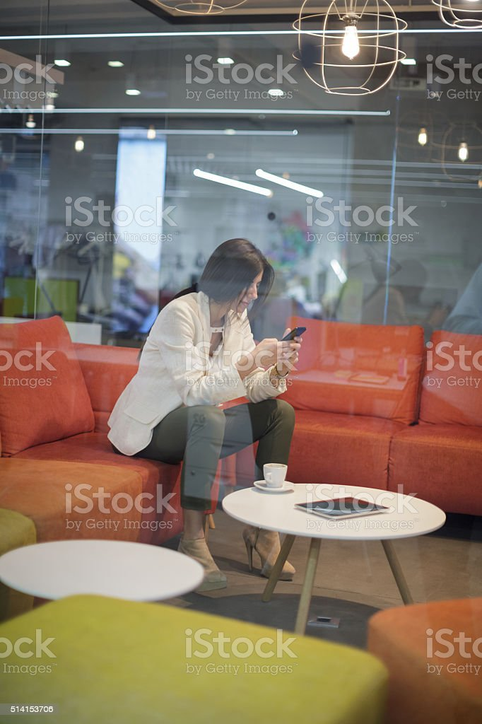 Woman text messaging stock photo