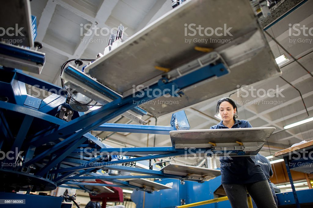 Woman textile printing at a factory stock photo