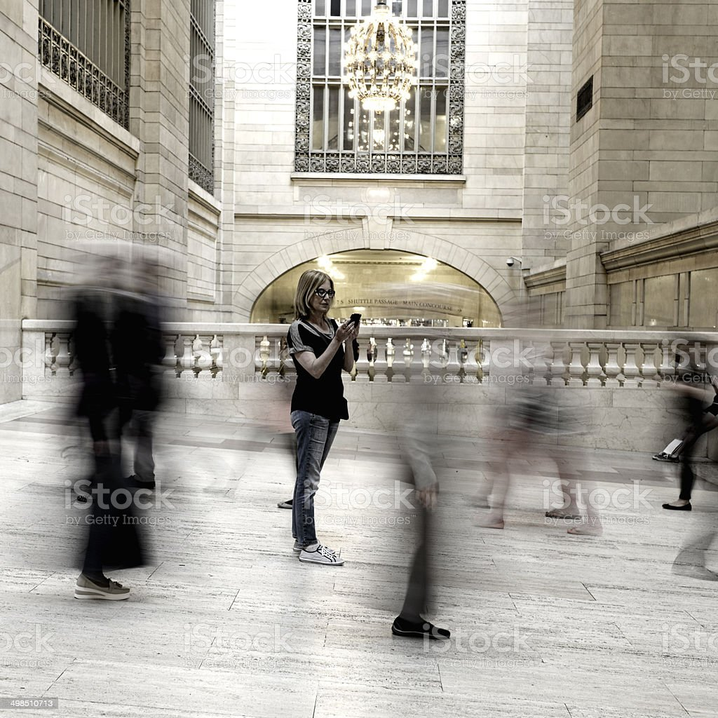 Woman Texting at Grand Central Station, NYC stock photo