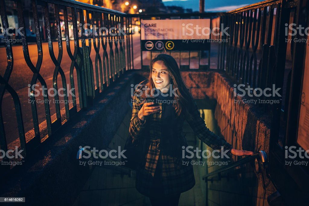 Woman texting at night stock photo
