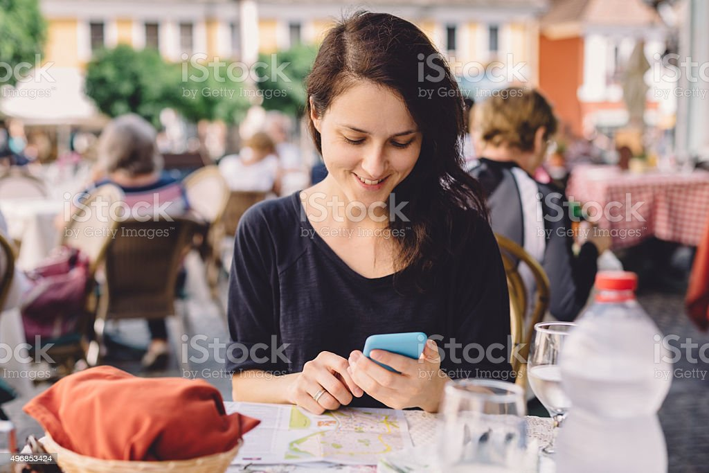 Woman texting in a cafe stock photo