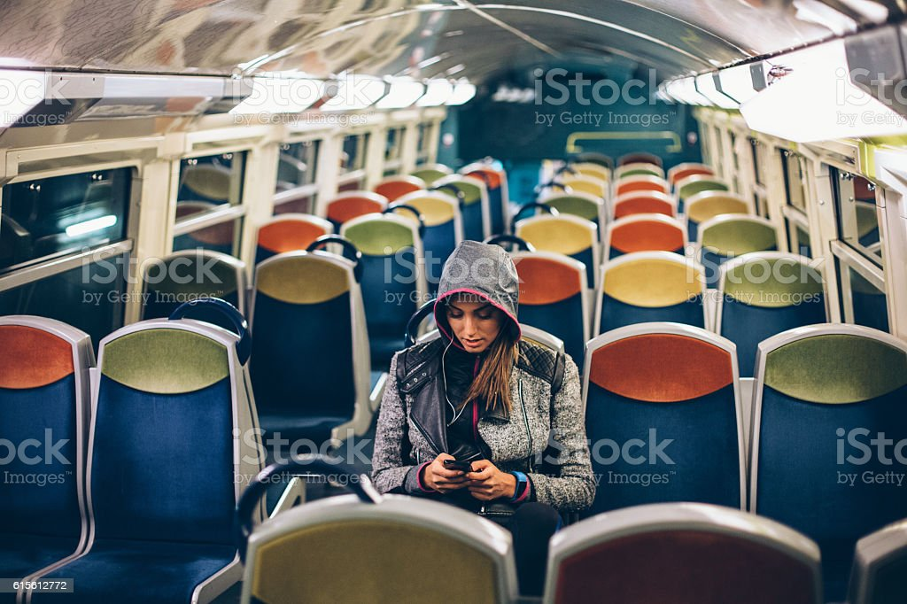 Woman texting in the metro stock photo