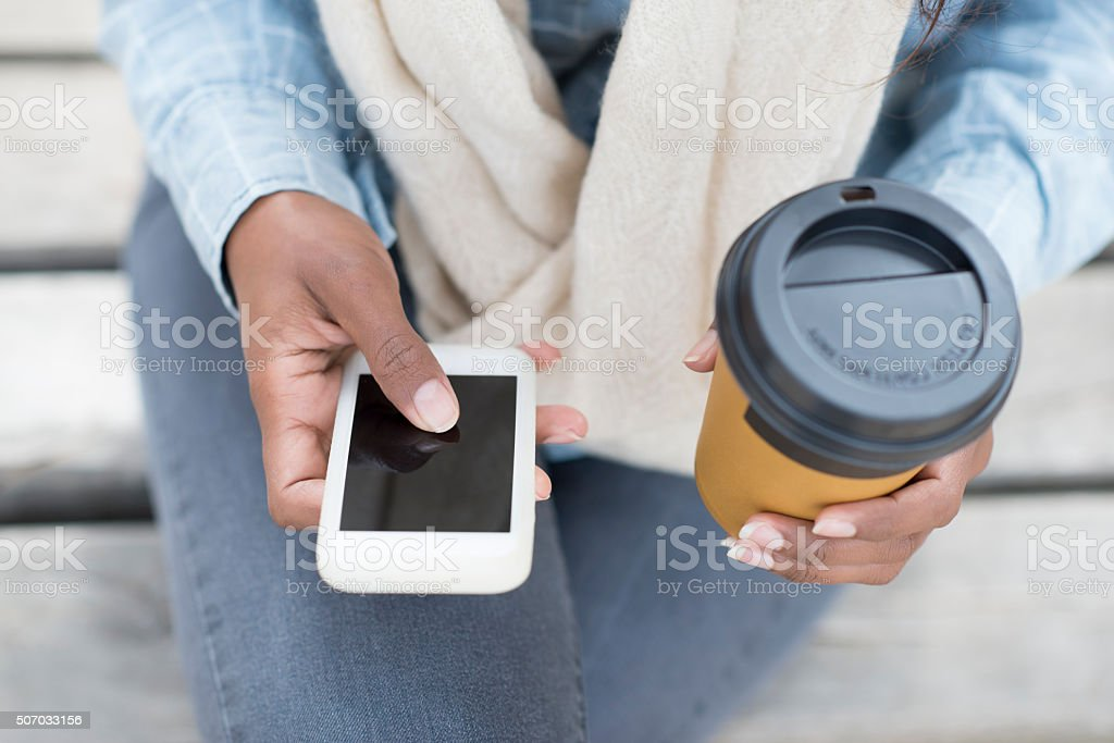 Woman texting on her cell phone. stock photo