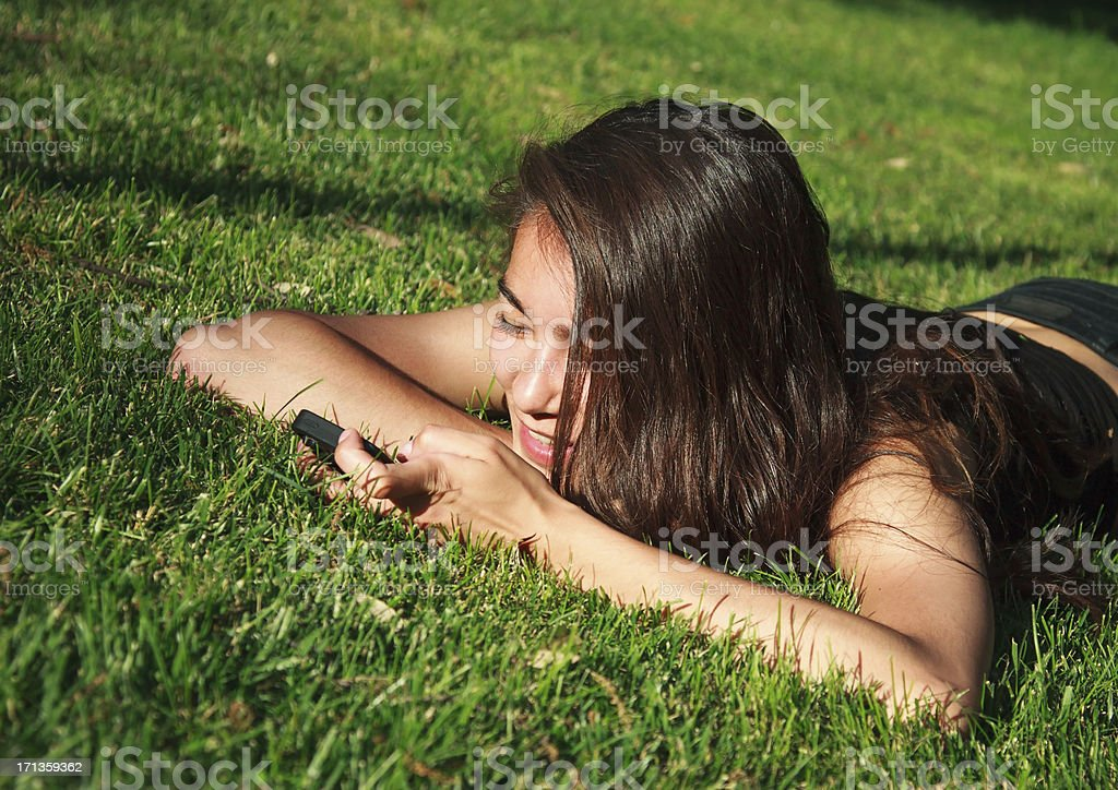 Woman texting on her cell-phone royalty-free stock photo