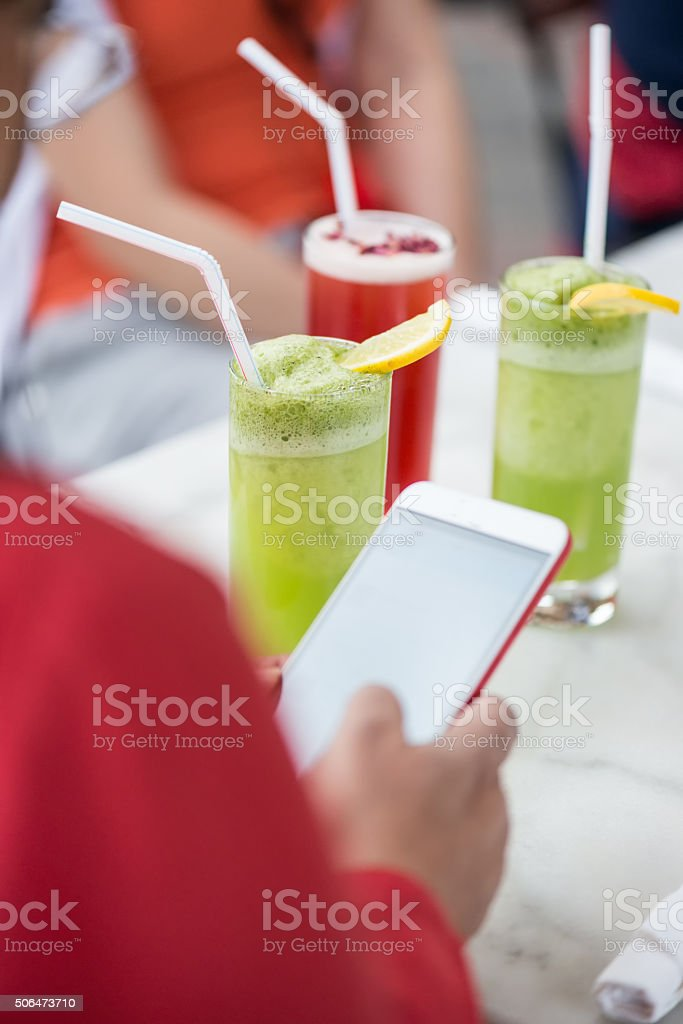 Woman Texting on Smartphone During Business Lunch at Outdoor Café stock photo