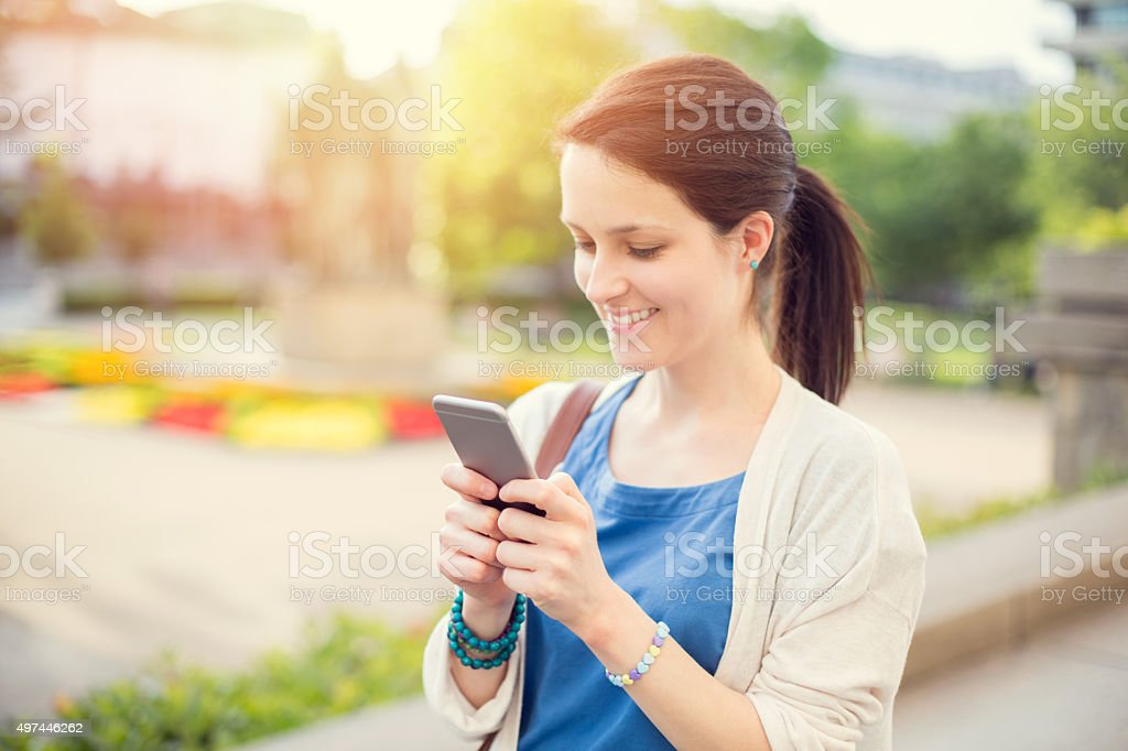 Woman waiting for Uber in Sofia stock photo