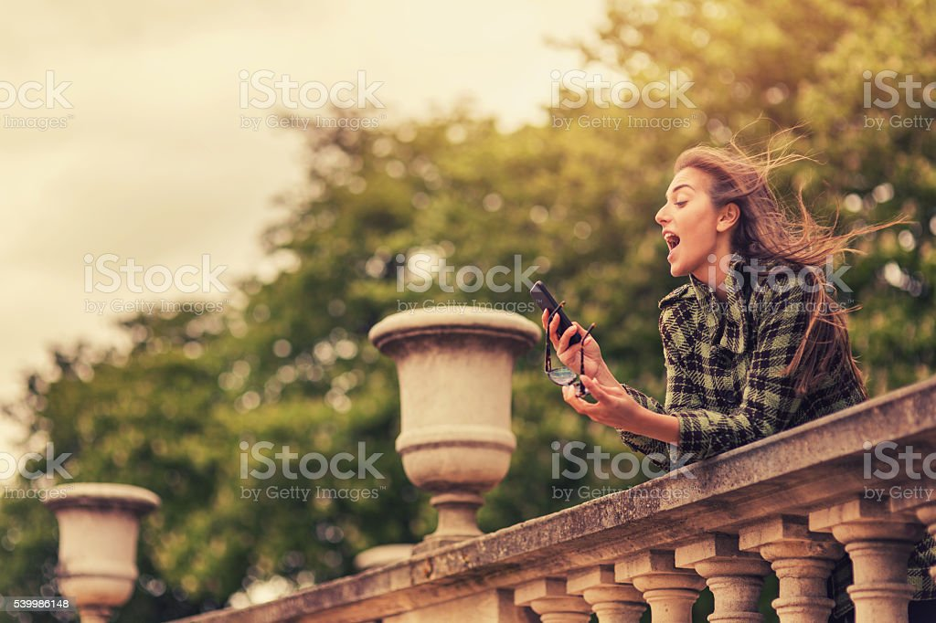 Woman texting on the phone in Paris stock photo