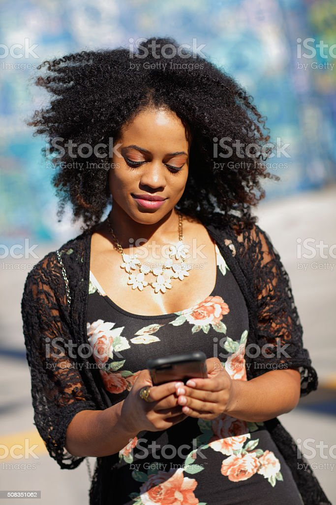 Woman texting on the phone stock photo