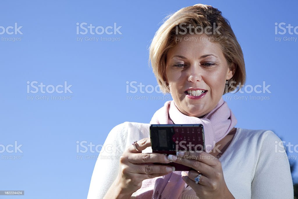 woman texting - outdoors royalty-free stock photo