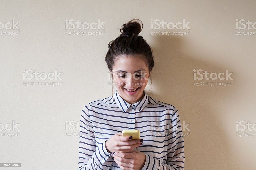 Woman texting stock photo