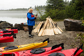 Woman texts before kayaking