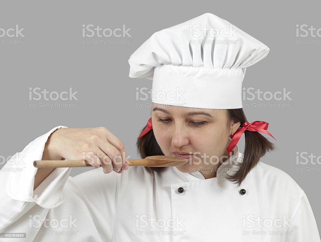 woman the cook holds spoon in a hand. royalty-free stock photo
