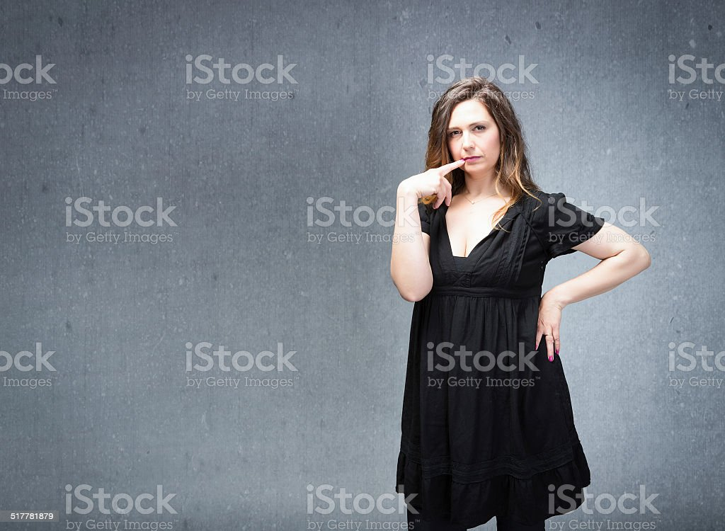 woman think in a pensive emotion stock photo