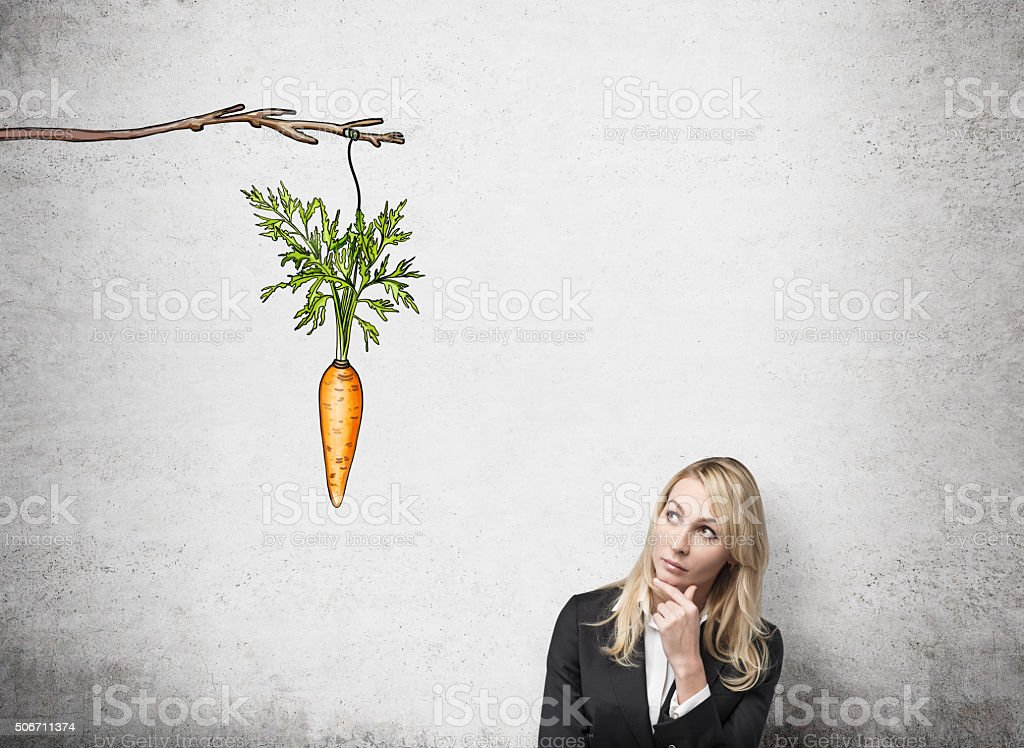 Woman thinking about reward stock photo