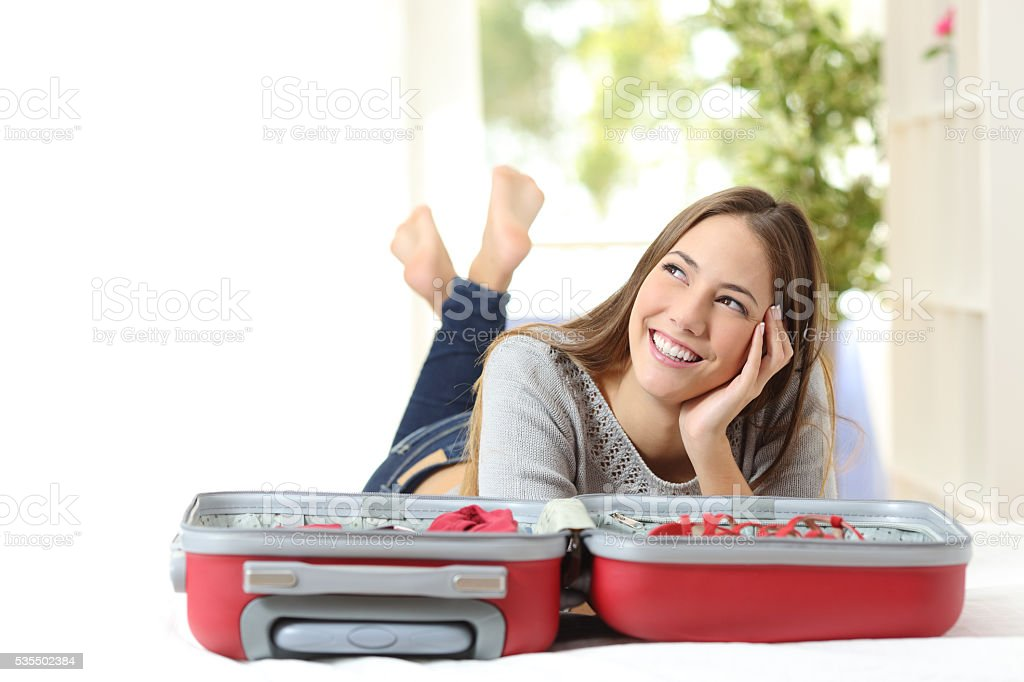 Woman thinking and preparing a travel stock photo