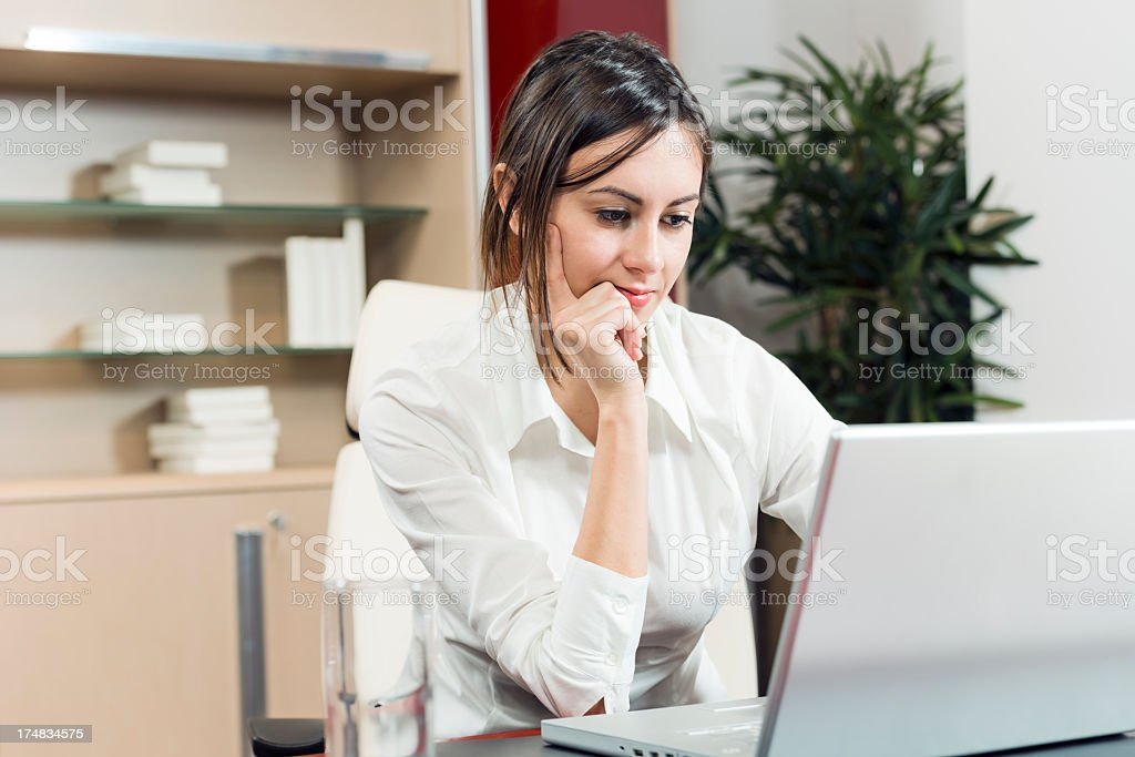 Woman thinking at her project royalty-free stock photo
