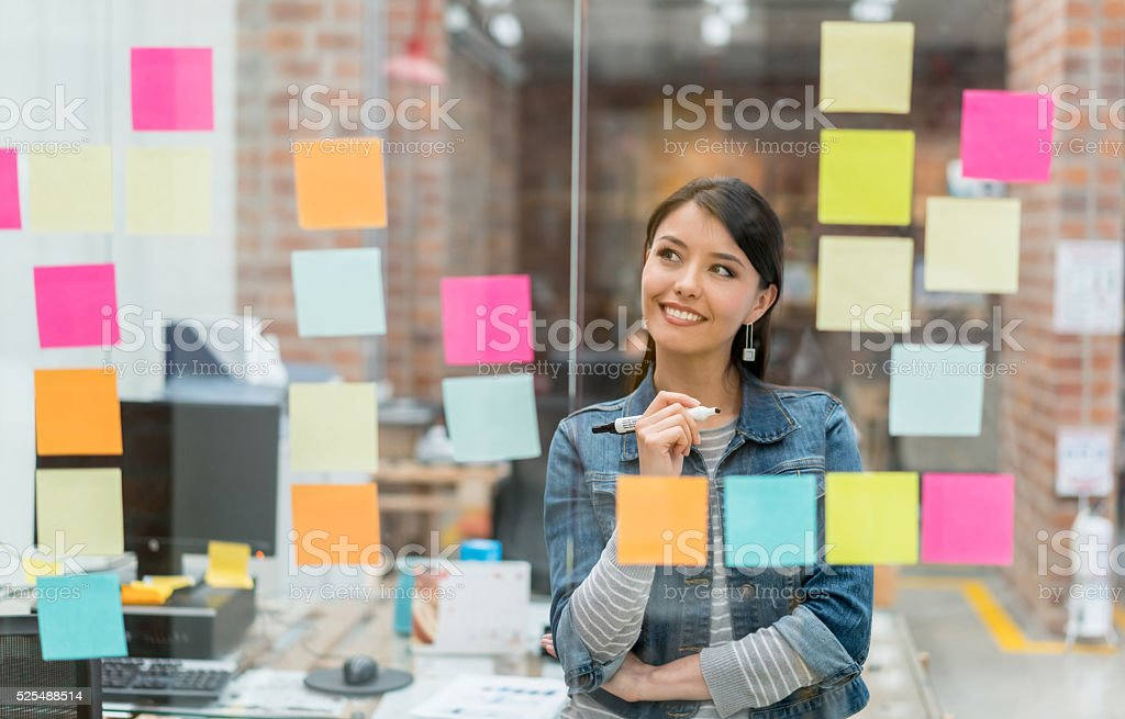 Woman thinking of ideas at the office stock photo