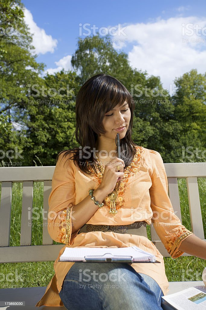Woman thinking on park bench royalty-free stock photo