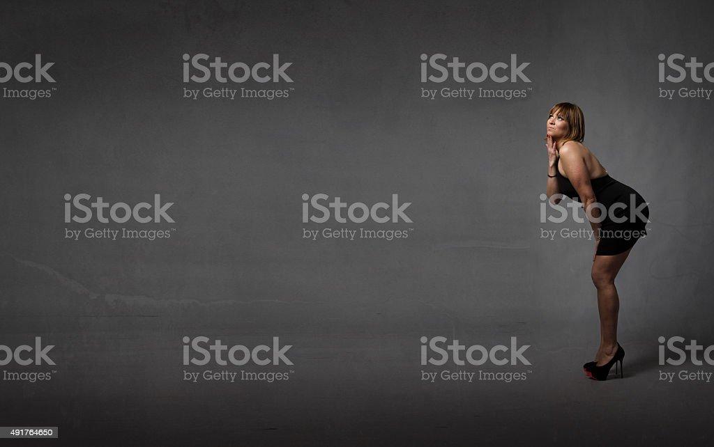 woman thinking wiht hand under head stock photo
