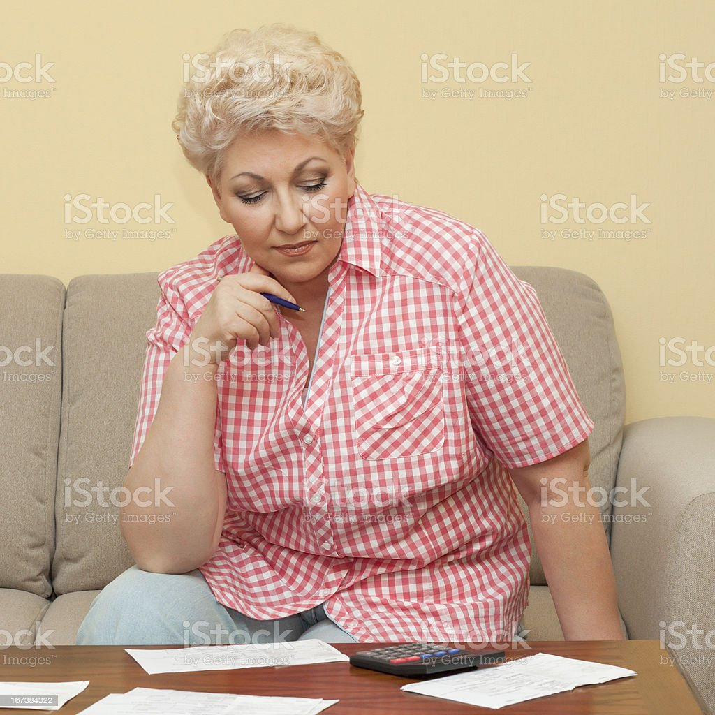 woman thinks about her debts royalty-free stock photo