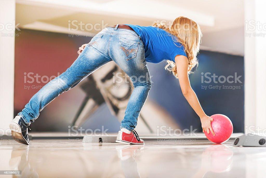 Woman throwing bowling ball. royalty-free stock photo
