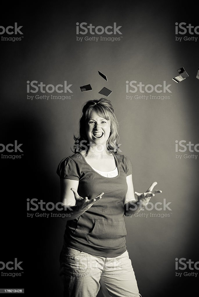 woman throwing credit card pieces stock photo