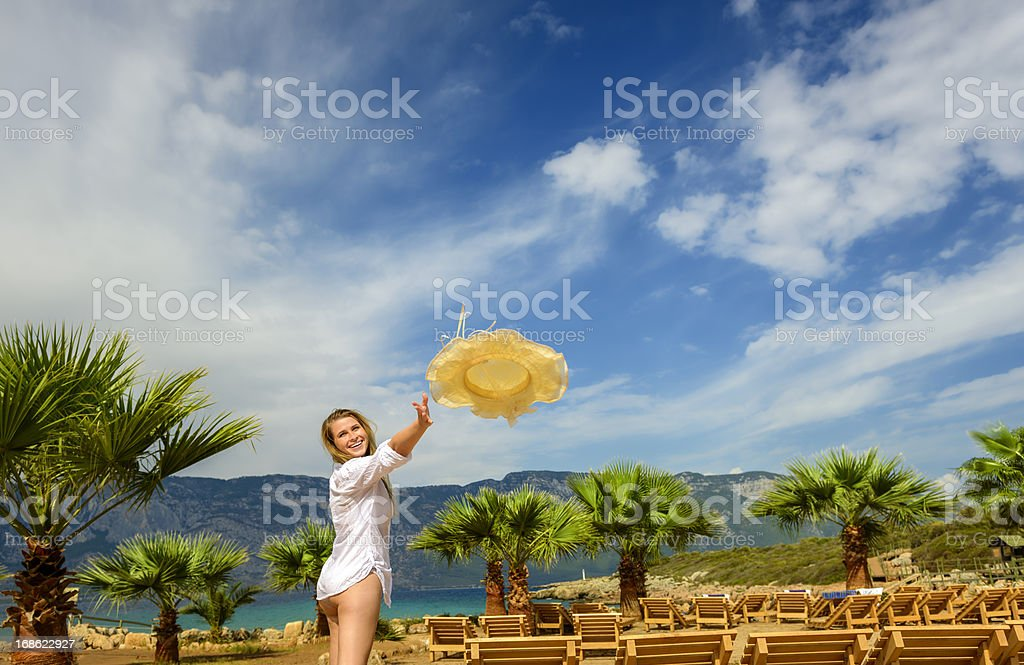 woman throwing hat royalty-free stock photo