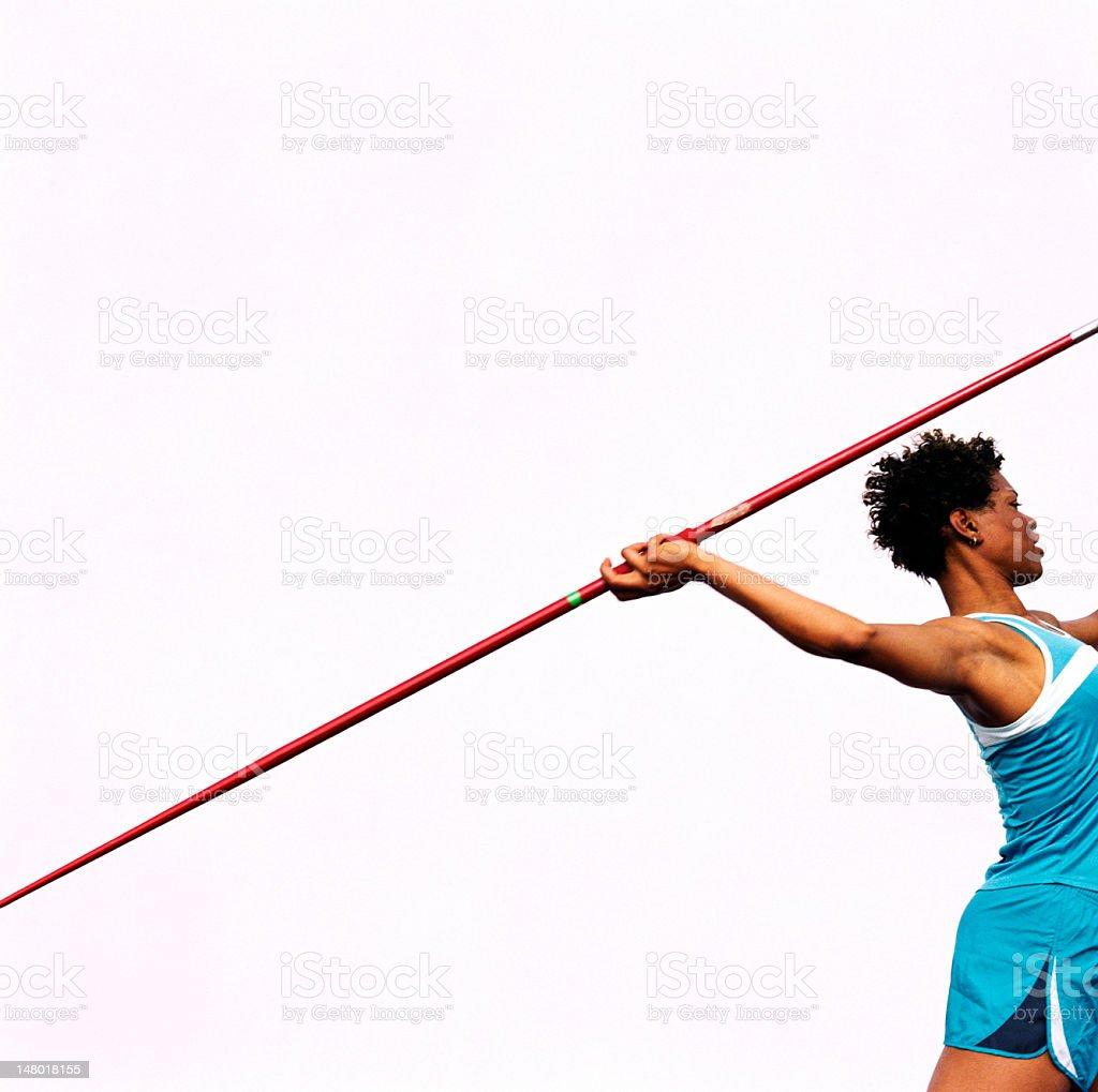 Woman throwing javelin, side view stock photo