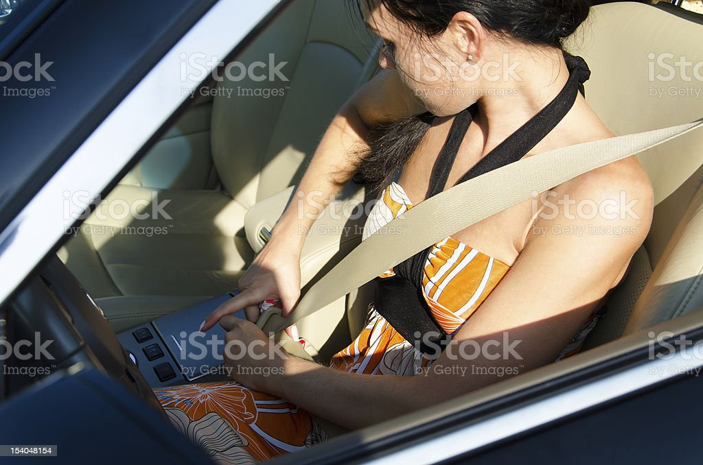 Woman tightening her safety belt stock photo