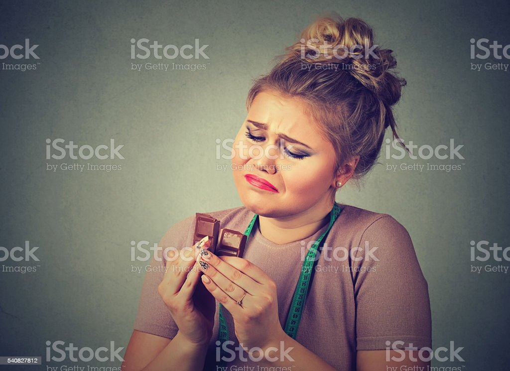 woman tired of diet restrictions craving sweets chocolate stock photo