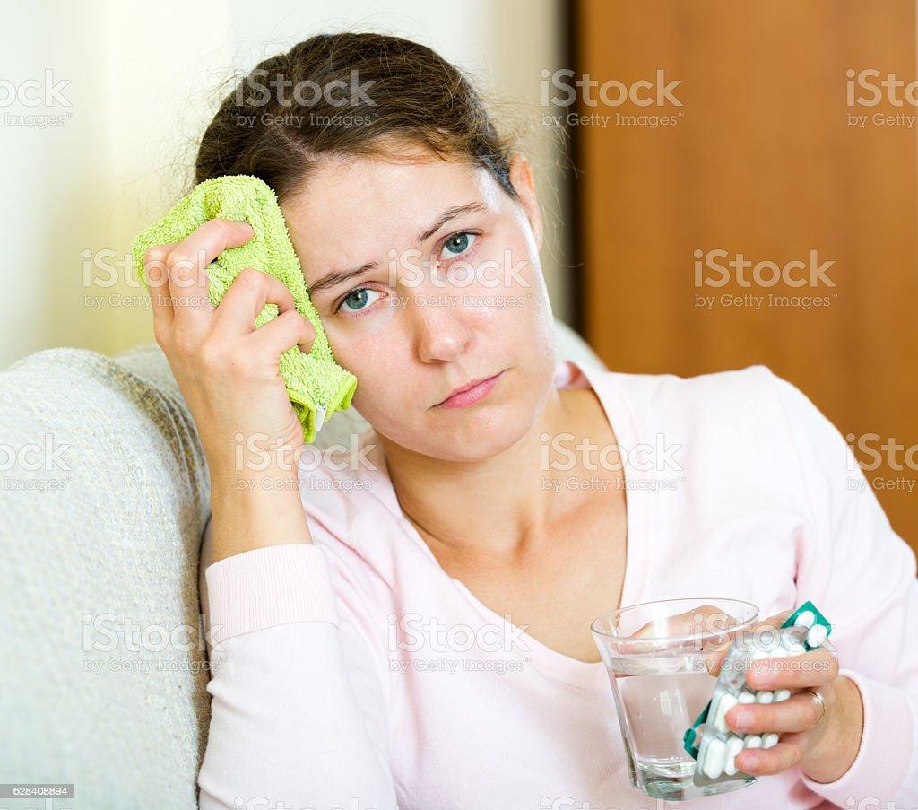 Woman tired of problems having headache stock photo