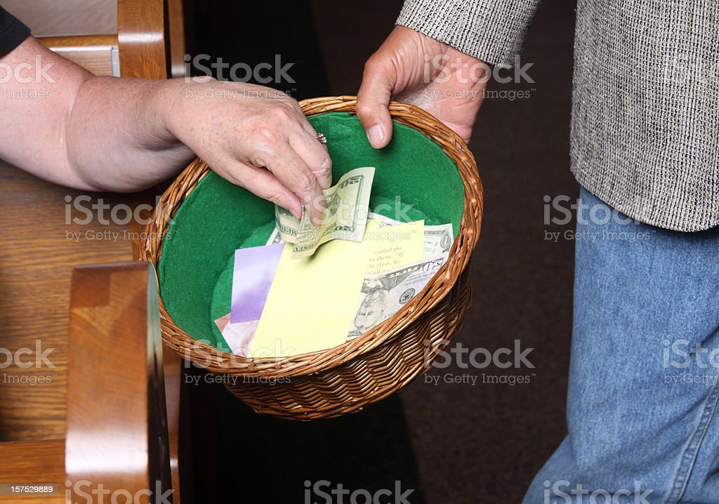 Woman Tithing stock photo