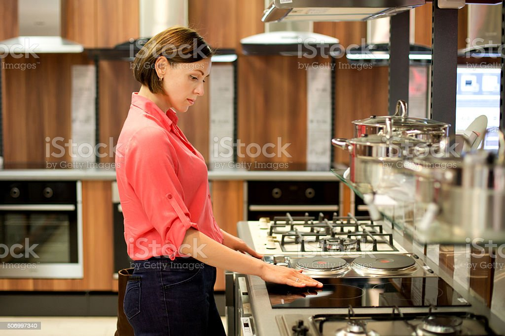 woman to buy the stove stock photo
