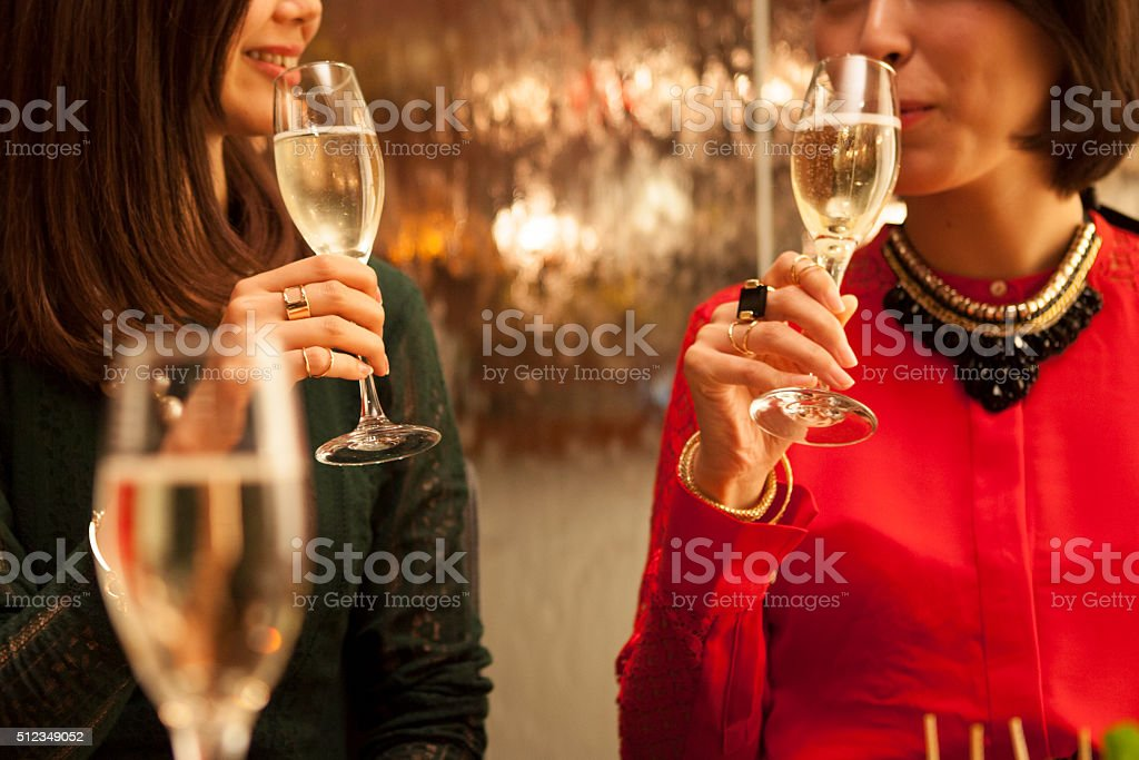 Woman to taste the champagne stock photo