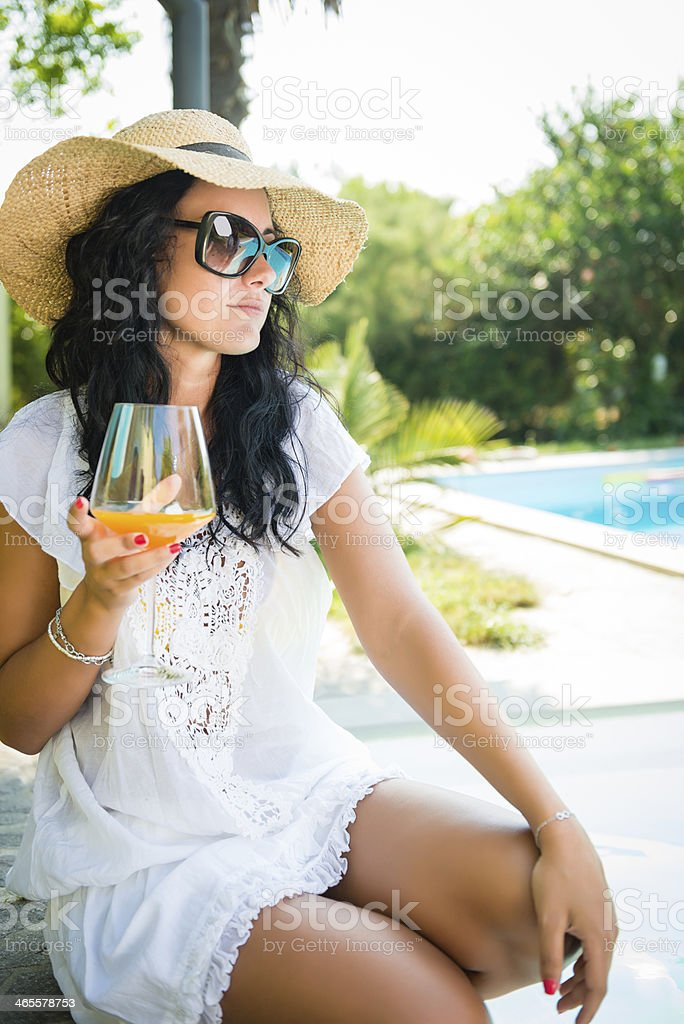 Woman toasting near the swimming pool royalty-free stock photo