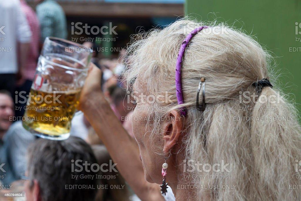 Woman toasting royalty-free stock photo