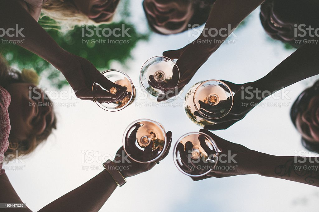 Woman toasting with sparkling wine and champagne stock photo